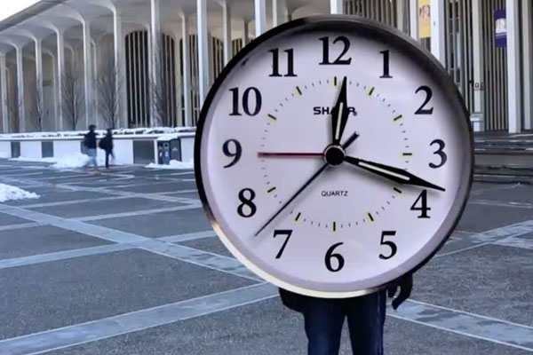 a person holding a clock that covers all but their legs