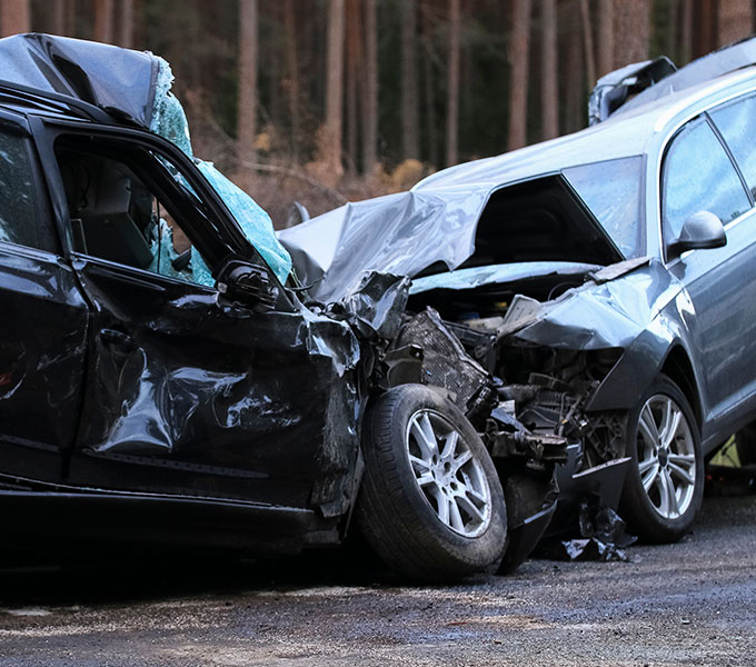 2 cars that have had a very bad crash