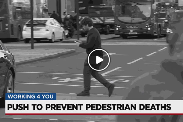Push to prevent pedestrian deaths in Nashville - guy walking across the street looking at his phone