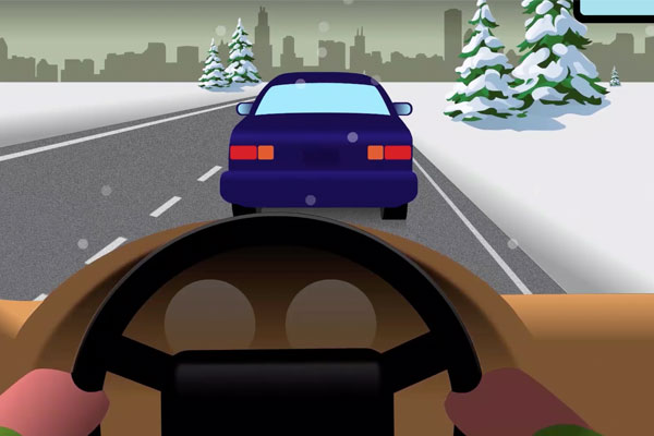 driver's view of driving in winter conditions with a car in front and snow