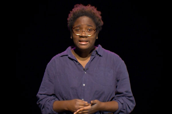 an african american teen with a black background