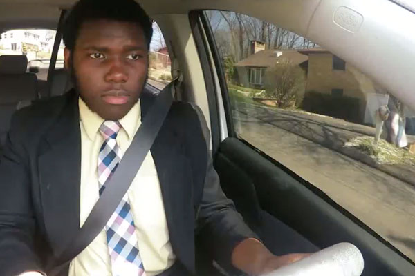 an african american young man driving a car