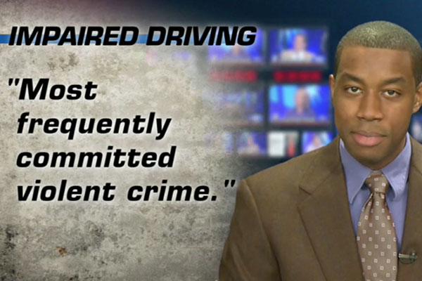 An anchor man with a chyron about impaired driving