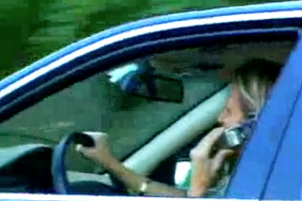 woman driving talking on her cell phone