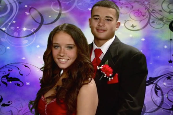 a teen couple at prom smiling with a purple background